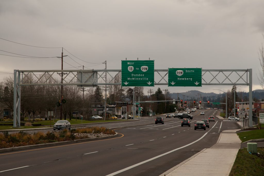 A new sign gantry over 99W just north of the Springbrook Rd. intersection, put up sometime in 2017. The sign implies that OR-18 follows Springbrook and a slight portion of OR-219 before turning onto the bypass. Also, 99W still goes through Dundee, but ODOT omits it from the 99W southbound sign to encourage use of the bypass.