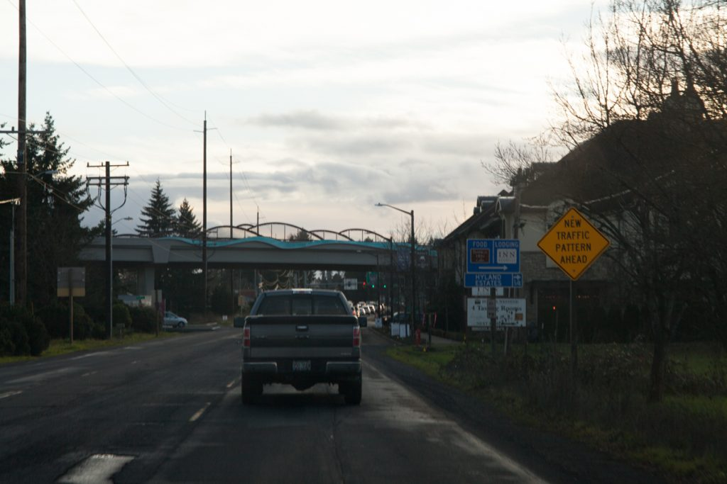 "Approaching the bypass southbound on OR-99W in downtown Dundee. In case the big bridge didn't give it away, a ""New Traffic Pattern Ahead"" sign indicates the upcoming intersection with the bypass."