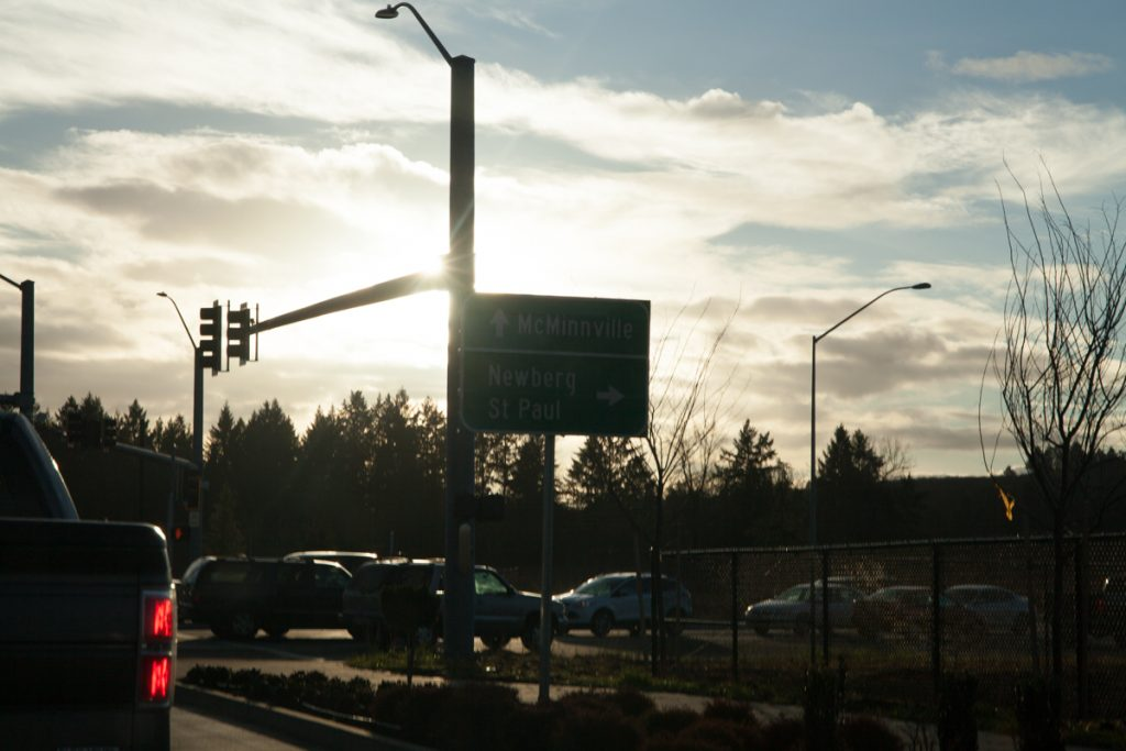 Directional signs for McMinnville and Newberg/St. Paul. I tried to block as much sun as I could to get this shot.