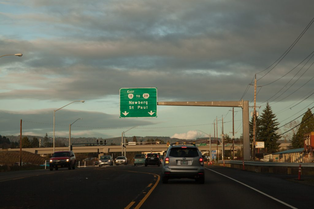 An overhead sign for OR-18 East to OR-219. I'm a bit surprised Portland isn't listed as a control city in this direction, since a fair amount of travelers head between the Portland area and Grand Ronde/the Oregon coast. I bet ODOT believes people will put 2 and 2 together that the road to Newberg = the road to Portland. Also, we get a cardinal direction for OR-18 in this direction, but not going the other direction. This is pretty standard for Oregon when one direction is considered more important than the other.