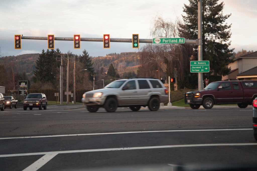 Northbound traffic gets its own right turn arrow phase at this traffic light. The two signs in this photo are new.