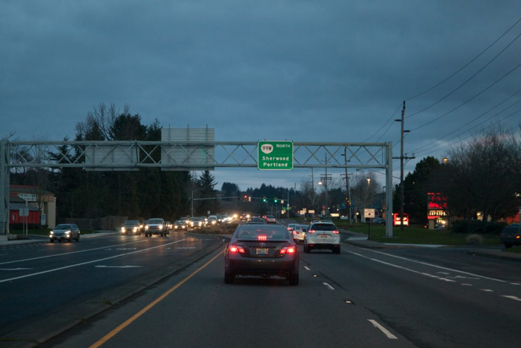 As darkness sets in, one final shot of the sign gantry north of Newberg, reassuring drivers that this takes you back to Portland.