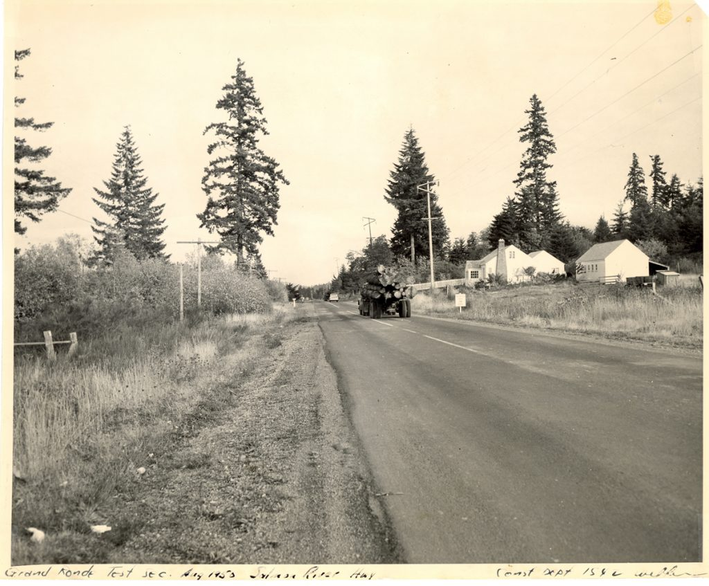 A logging truck travels along the Salmon River Highway near Grand Ronde, August 1950 (OSHD #1540)