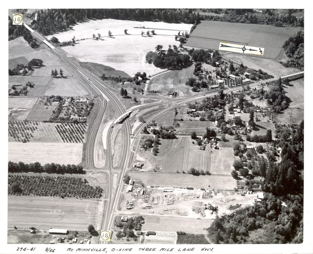 The East McMinnville interchange where Three Mile Lane diverges northwesterly (to the right) from the Salmon River Highway, September 1966. The design of this interchange started causing more accidents as traffic increased, necessitating a redesign (OSHD 274-41)