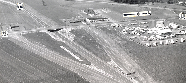 """Westbound OR-18 at the South McMinnville interchange / US-99W junction, April 1967. The BGSs at the gore point show control cities of """"Lincoln CIty"""" and """"Corvallis / McMinnville"""" for OR-18 and US-99W respectively. Curiously, the """"99"""" is stacked over the """"W"""" on the US-99W shield (OSHD 292-42)"""